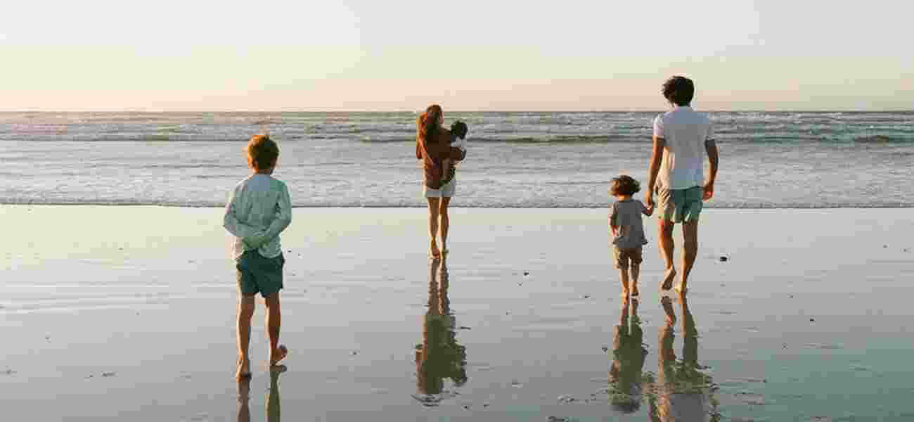 A family walk towards the sea at Polzeath beach, near Highcliffe Holidays, in north Cornwall.