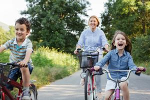 A family cycle the Camel Trail with bikes from Bridge Bike Hire.