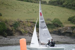 Two men sail on the River Camel with the Rock Sailing and Water Ski Club.