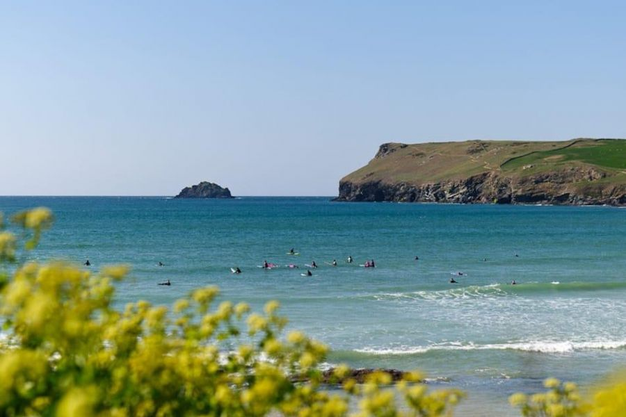 Polzeath beach and the north Cornish coast, where Highcliffe Holidays is located.